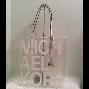 Michael KORS clear large tote with white handles.